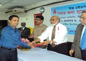 YPSA received crest on World Aids Day'10 Celebration program of Northern University Campus at Dhaka.