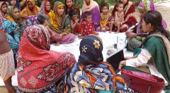 Yard meeting health worker