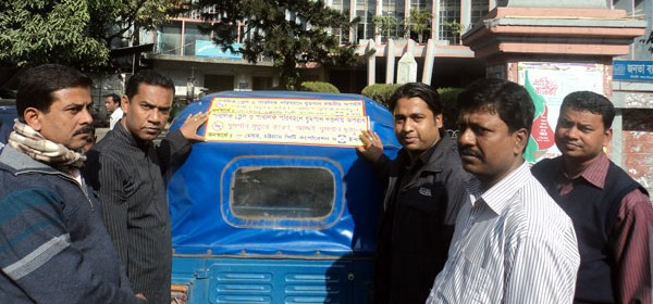 Counselor of 15 no ward of Chittagong City Corporation attaching smoke-free stickers behind the Taxi with the support of YPSA
