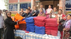 A beneficiary receives warm blanket from Md. Arifur Rahman