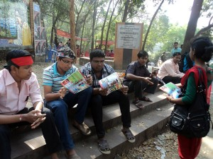 Volunteer distributed promotional materials to the public on International Mother Language day