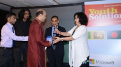 Vashkar Bhattacharjee from YPSA, Bangladesh receiving crest.
