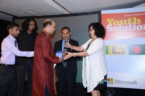 Vashkar Bhattacharjee from YPSA, Bangladesh receiving crest.