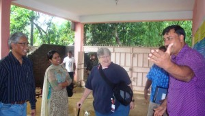 USAID evaluation team members in front of Shelter Home