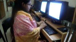 Youth woman with disability operating a computer in IRCD lab