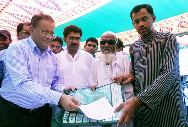 State Minister for Environment and Forests Dr Hasan Mahmud distributing insecticide-treated mosquito net