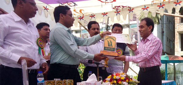 Md. Mahabubur Rahman, Director (SD), YPSA receiving crest