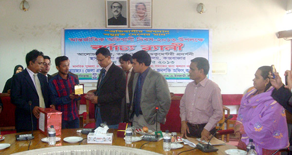 Successful migrant receiving crest from DC of Cox'sbazar