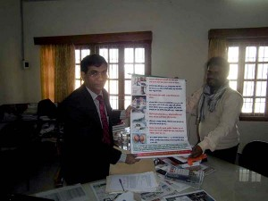 Government Official receiving festoon from YPSA official