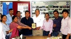 YPSA officials are handing over official crest (Memento) to Adv. Moktader Billah.