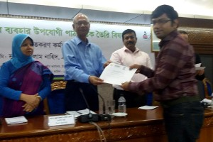 Mr. Tilak Kanti, YPSA receiving certificate from Education Minister Nurul Islam Nahid