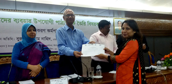 Ms. Shahed Khanam Naly receiving certificate from Education Minister