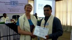 Md. Arifur Rahman receives Certificate of Appreciation from Ms. Sara Stephens of Winrock International