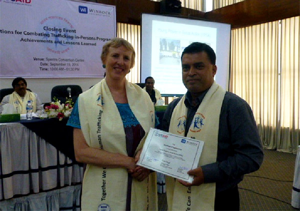 Md. Arifur Rahman receives Certificate of Appreciation from Ms. Sara Stephens of Winrock International