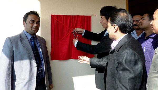 Mr. Hideshi Sasahara, First Secretary of the Japan Embassy in Bangladesh uncover the founding stone of Cox's Bazar at the opening ceremony.