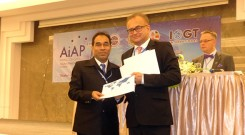 Mahabubur Rahamn receiving certificate from president of IOGT International.