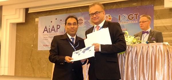 Mahabubur Rahamn receiving certificate from president of IOGT International.