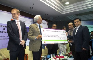 honorable adviser of the Prime Minister Prof. Dr. Gowher Rizvi handover the cheque to Md. Arifur Rahman, CE and Vashkar Bhattacharjee. PM of YPSA