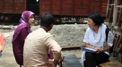 Heidi Chan with an interviewer and respondent in the field