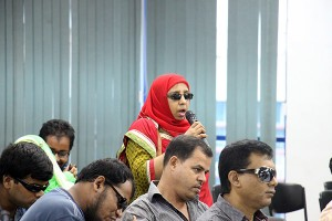 A visually impaired asking a question in the seminar