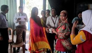 A women worker receiving promotional material