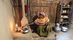 Forest Dependent Group (FDG) member cooking with an Improved Cookstoves (ICS)