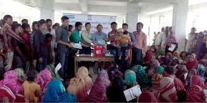 Affected people receiving hygeine kits