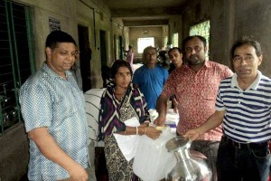 A woman receiving relief support at South Mithachari in Ramu