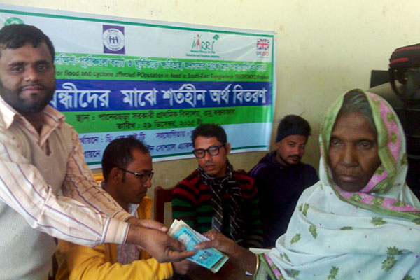 YPSA provides financial aid to the persons with disability affected by cyclone Komen and flash flood in Cox'sbazar