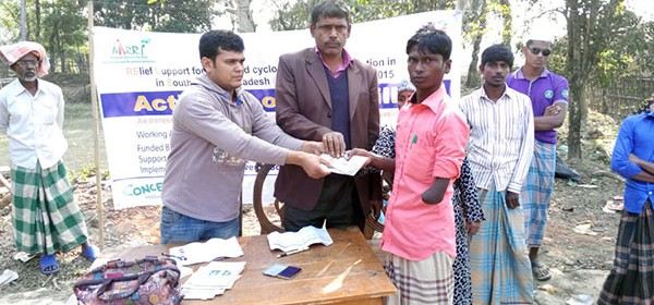 PWD receiving cash in Cox'sbazar