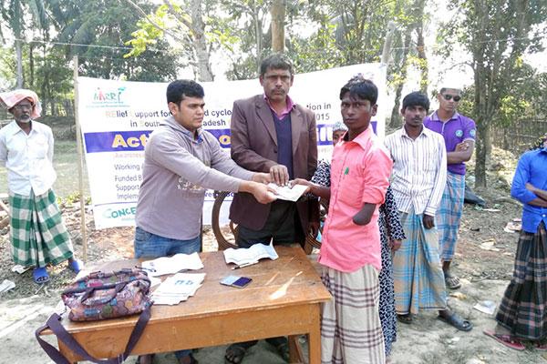 PWD receiving cash in Cox'sbazar