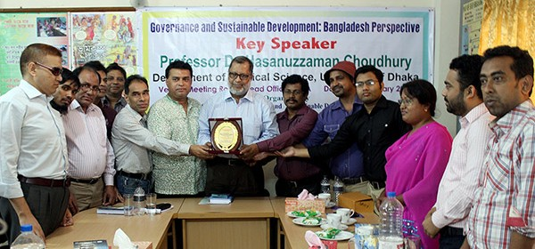 YPSA handovers a crest to Dr. Hasanuzzaman Chowdhury