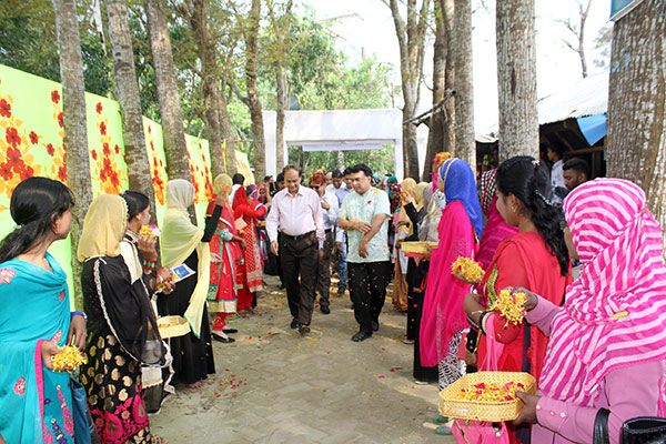 Woman welcoming PKSF director