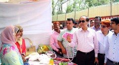 Managing Director of PKSF visiting a stall at the fair