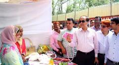 Managing Director of PKSF visiting a stall at the fair