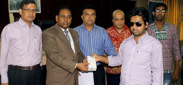 Visually impaired student of University of Chittagong receiving smart phone
