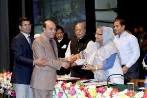 Prime Minister holding the hand of Vashkar Bhattacharjee