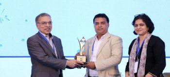 Chief Executive of YPSA Md. Arifur Rahman receives the award crest