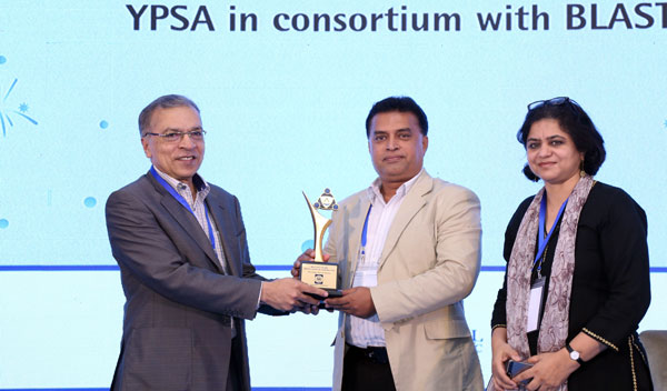 Chief Executive of YPSA Md. Arifur Rahman receives the award crest