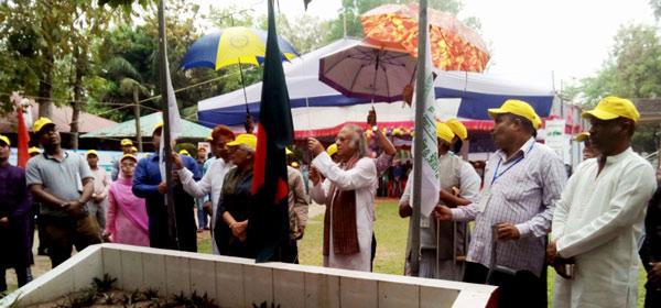 Dr. Qazi Kholiquzzaman Ahmad, President of Palli Karma-Sahayak Foundation (PKSF) inaugurating the convention raising the national flag