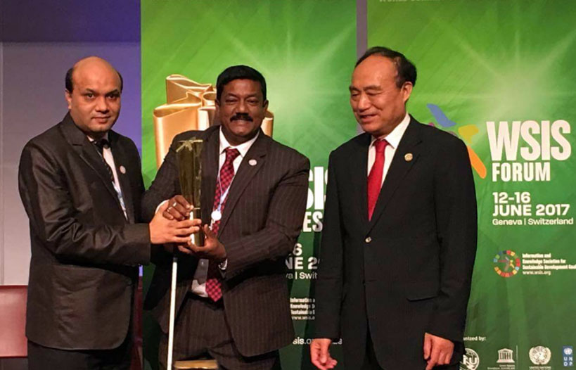 Vashkar Bhattacharjee of YPSA and Kabir Bin Anwar of a2i receiving trophy from ITU's Secretary General Mr. Haolin Zhao.