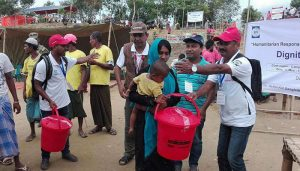 A woman has received dignity kits