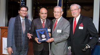 Vashkar is receiving award.