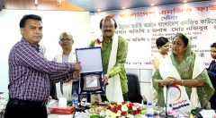 Principal Secretary of the Prime Minister's Office handover the award plaques to Md. Arifur Rahman