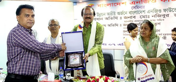 Principal Secretary of the Prime Minister's Office handover the award plaques to Md. Arifur Rahman