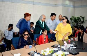 PKSF chairman handovers a phone to a woman with visually umpired student 3
