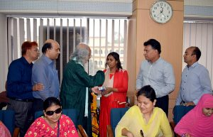 PKSF chairman handovers a phone to a woman with visually umpired student 4
