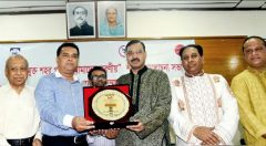 Md. Arifur Rahman, Chief Executive of YPSA receiving plaque from Mayor