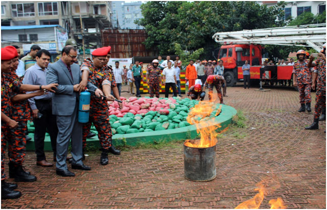 A.Z. M. Nasir Uddin inaugurated an emergency mock drill by putting out a fire with an extinguisher