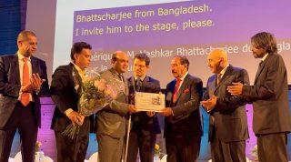 Vashkar of YPSA from Bangladesh receiving UNESCO award